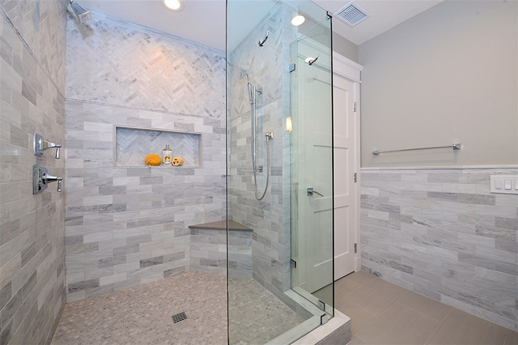 white stone tile in bathroom